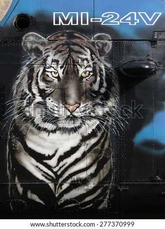 PILSEN, CZECH REPUBLIC - MAY 2, 2015: Tiger nose art on Mi-24V Hind military helicopter from Czech Air Force. Member of NATO Tiger Association. Liberation festival in Pilsen. - stock photo