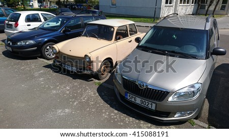 PILSEN, CZECH REPUBLIC - MAY 3, 2016: Trabant 1.1, a vintage car parking between modern cars. Famous car Trabant was produced in communist East Germany in years 1963-1991. - stock photo