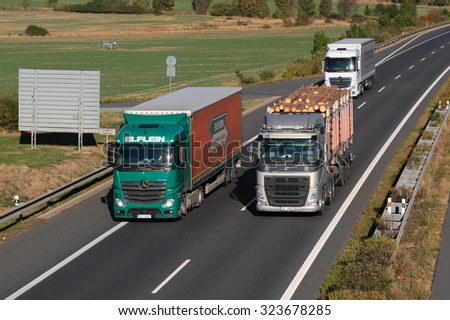 PILSEN, CZECH REPUBLIC - OCTOBER 1, 2015: Dangerous overtaking of trucks on D5 highway. Cause of frequent car accident. The D5 is important transport connection between West Bohemia and Germany. - stock photo