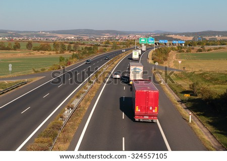PILSEN, CZECH REPUBLIC - OCTOBER 2, 2015: Line of trucks on the D5 highway. The D5 is important transport connection between West Bohemia and Bavaria in Germany. - stock photo
