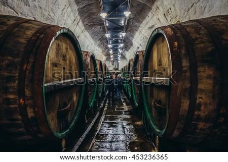 Pilsen, Czech Republic - October 3, 2015. Old wooden barrels in cellars of Pilsner Urquell Brewery - stock photo