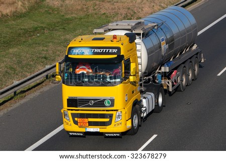 PILSEN, CZECH REPUBLIC - OCTOBER 1, 2015: Tank truck carrying chemicals on the D5 highway. The D5 is important transport connection between West Bohemia and Bavaria in Germany. - stock photo