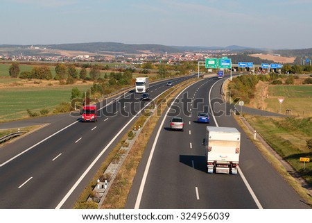 PILSEN, CZECH REPUBLIC - OCTOBER 1, 2015: Traffic on the D5 highway. The D5 is important transport connection between West Bohemia and Bavaria in Germany. - stock photo