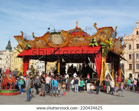 PILSEN, CZECH REPUBLIC - SEPTEMBER 28, 2014: Magical carrousel Le Manege Carre Senart on Namesti republiky square. Pilsen city celebrate title of the European Capital of Culture 2015. - stock photo
