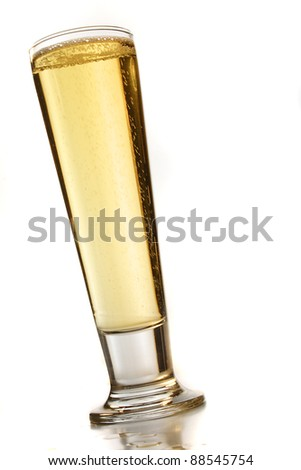 Pilsner glasses with light beer - stock photo