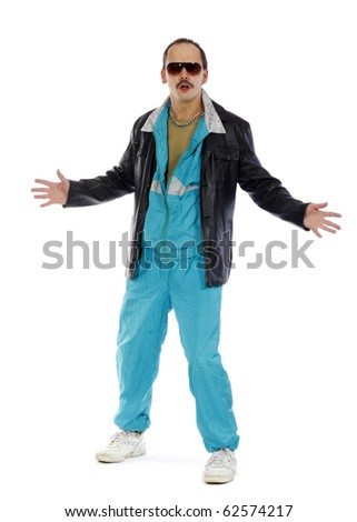Pimp, wearing a retro tracksuit and leather on white background - stock photo