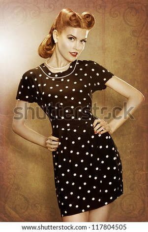 Pin-Up beautiful girl in classic fashion polka dots dress posing. Grunge. Retro style - stock photo