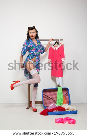 Pin-up girl. American style. dress and white stockings - stock photo