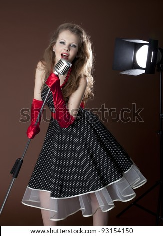 Pin-up girl and vintage microphone - stock photo