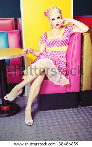 Pin up girl at a retro cafe similar available in my portfolio - stock photo