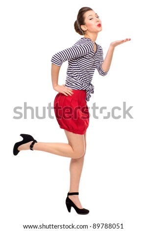 Pin-up girl blowing a kiss - stock photo