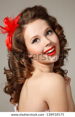 Pin-up girl close-up portrait.Professional make-up,hair and style. - stock photo
