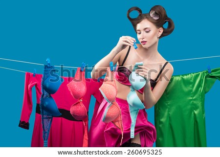 pin-up girl hangs bras - stock photo