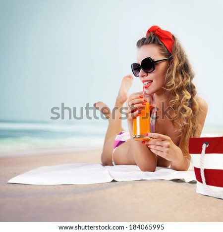 Pin-up girl on the beach - stock photo