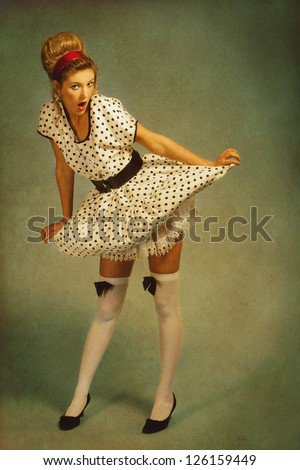 Pin up girl. Retro female portrait with added vintage paper texture - stock photo