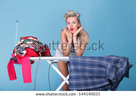 pin up girl retro style portrait woman ironing posing housewife with iron blue background