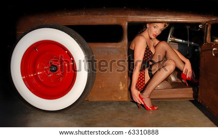 Pin Up Girl sitting in a Classic Rat Rod Car