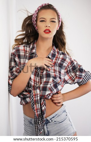 Pin-up girl wearing a headband - stock photo