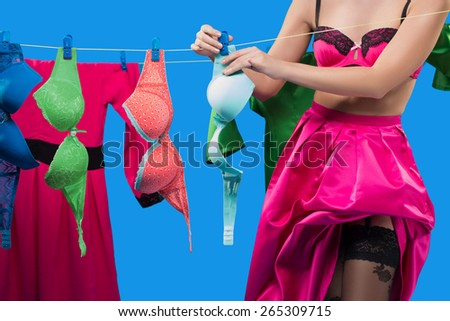pin-up girl with a basket with the laundry - stock photo