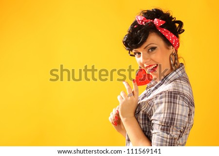 pin up girl with heart shaped lollipop