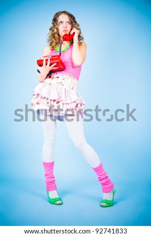 Pin-up girl with telephone looking angry - stock photo