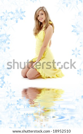 pin-up image of pretty lady in yellow dress on white sand - stock photo