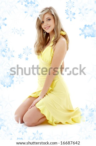pin-up image of pretty lady in yellow dress with snowflakes - stock photo