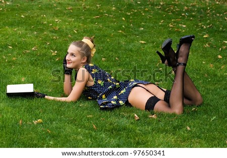 Pin up in the park - stock photo