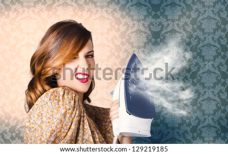 Pin Up Portrait Of A Hip Young Cleaning Girl Holding Steam Iron When Eliminating Creases With Hot Fashion Style - stock photo
