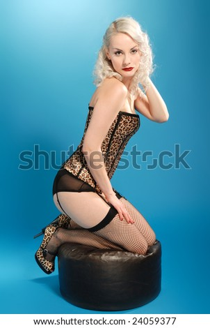 pin-up style beautiful blonde girl in  leopard skin costume - stock photo