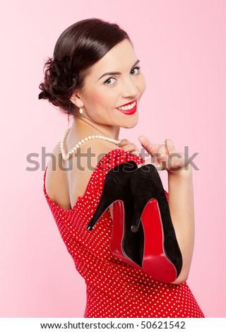 pin-up style portrait of beautiful brunette girl - stock photo