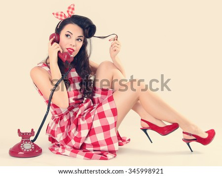 Pin up woman talking on the phone - stock photo