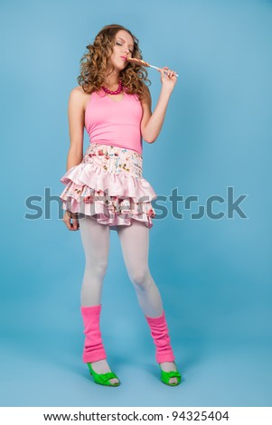 Pin-up woman with colorful lollipop smiling - stock photo