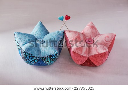 Pin with heart pinheads in pin cushions - stock photo