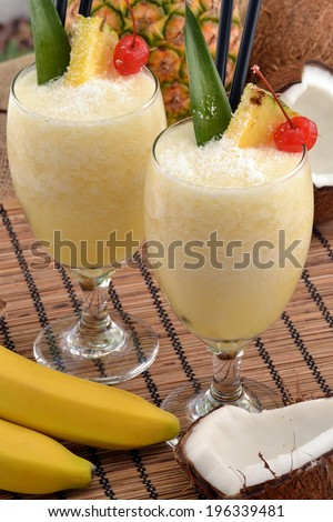 Pina colada cocktail drinks and tropical fruits. - stock photo