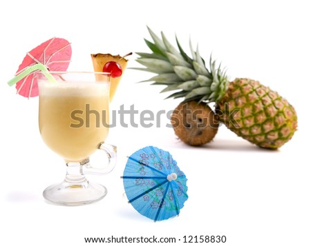 Pina Colada Cocktail isolated on white. Long drink to serve at any time. Ingredients: 1 slice fresh pineapple, 5-6 ice cubes, 1 white Puerto Rican rum, 3 pineapple juice, 8 mixing spoons coconut milk - stock photo