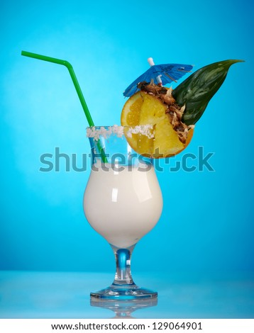 Pina Colada - Cocktail with Cream, Pineapple Juice and Rum on blue background