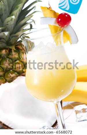 Pina Colada cocktails surrounded by tropical fruits. Rum, pineapple juice, coconut cream  garnished with slice of pineapple, coconut and maraschino cherry. Most popular cocktails series. - stock photo