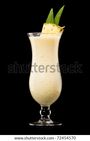 Pina colada drink cocktail glass isolated on black background - stock photo