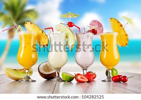 Pina colada drinks with blur beach on background - stock photo