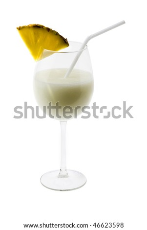 Pina Colada mixed drink with umbrella garnish on white background