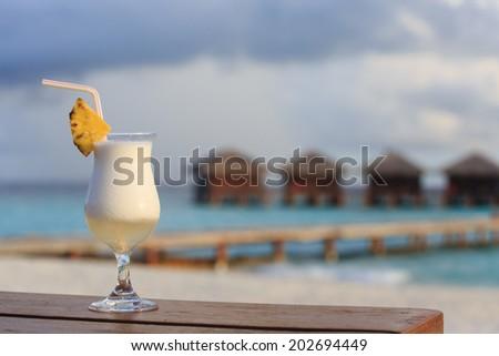 pina colada on tropical beach - stock photo