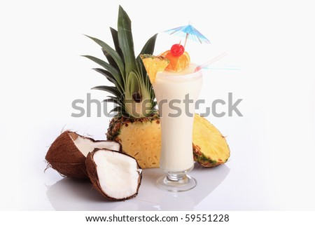 Pina Colada over white background, garnished with slice of pineapple and orange.