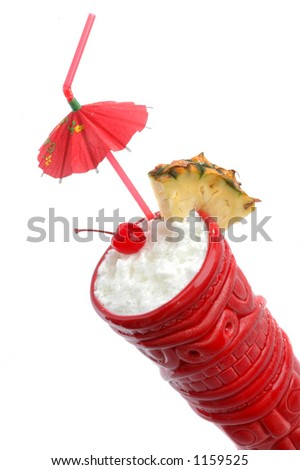 Pina Colada, served in a red tiki mug photographed on white. A tropical drink made with coconut milk, pineapple juice and rum. - stock photo