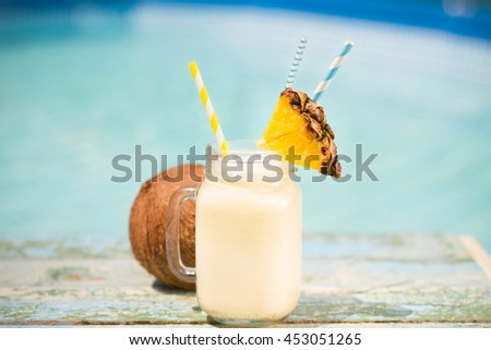 Pinacolada drink in cocktail jam on the beach - stock photo