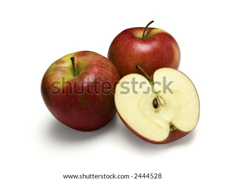 Pinata apples. Two whole and one cut in half. Isolated on a white background. - stock photo