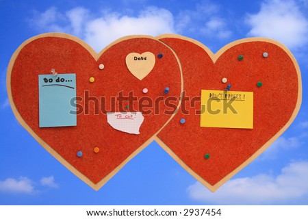 Pinboard in heart-shape with blue sky background - stock photo