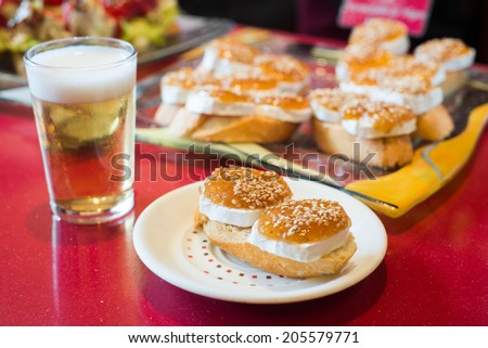 Pinchos, traditional Basque Country appetizer. Served with beer - stock photo