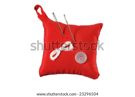 Pincushion, needle, thread and button isolated on white background - stock photo