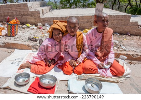 Pindaya, Myanmar - March 20,2011:Burmese nuns celebrate Pindaya Caves Festival, Pindaya, Shan State in Myanmar.Pindaya, a three hour drive from Helo is a city located in the hills of the Shan State. - stock photo